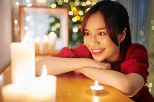 Woman looking at burning candles