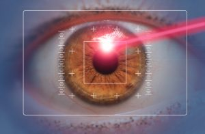 laser eye surgery concept, red laser beam hitting amber eyes