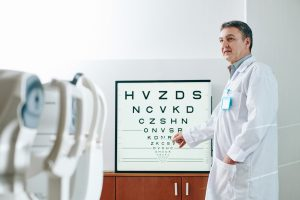 Ophthalmologist checking eyesight of patient