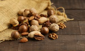 nuts mix on wooden background, healthy food