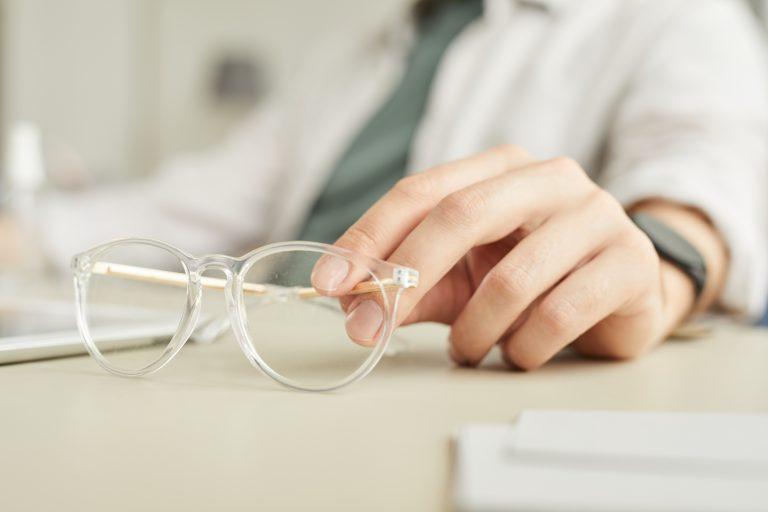 Businessman Holding Glasses Close Up