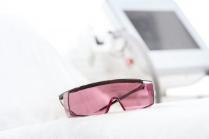 Close-up view of UV protective glasses for laser skin care