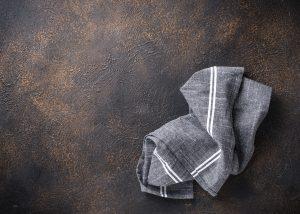 Gray linen napkin on rusty table